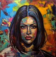 Junior Gonzalez paints super-sized portraits on exhibit now at Gallery 40.