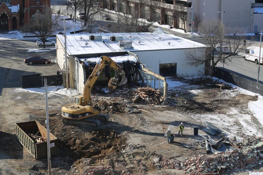 Demolition continues at 49 Civic Center Plaza in the City of Poughkeepsie on Jan. 21, 2020. Page Park Associates, the owners of the plaza which once contained Take 5 Deli, plan to construct  a four-story office building in the space as part of the Journal Square development project.
