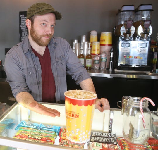 Mike Budge, owner and programmer of Story Screen Beacon Theater with their gourmet popcorn on January 15, 2020.