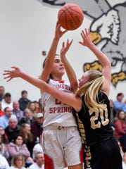 Bailey Oehmig of Bermudian Springs passes the ball while covered by Delone Catholic's Brooke Lawyer,Monday, January 20, 2020,John A. Pavoncello photo