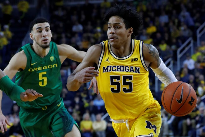Michigan's Eli Brooks is seen here in action earlier this season against Oregon. The Spring Grove High School graduate is averaging more than 11 points per game and shooting nearly 40% from 3-point range.
