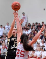 Delone Catholic's Makenna Mummert, seen here in a file photo, had 15 points in the Squirettes' first-round state playoff victory.