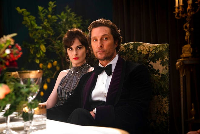 "Michelle Dockery, left, and Matthew McConaughey star in ""The Gentlemen."" The movie opens Thursday at Regal West Manchester, Queensgate Movie 13 and R/C Hanover Movies."