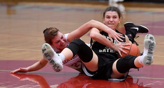 Maggie Hughes of Delone Catholic and Keri Speelman of  Bermudian Springs battle for a loose ball, Monday, January 20, 2020,John A. Pavoncello photo