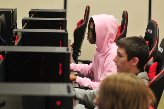 Richmond High School students experiment with the new e-sports equipment during a lunch period on Friday, Jan. 17, 2020.