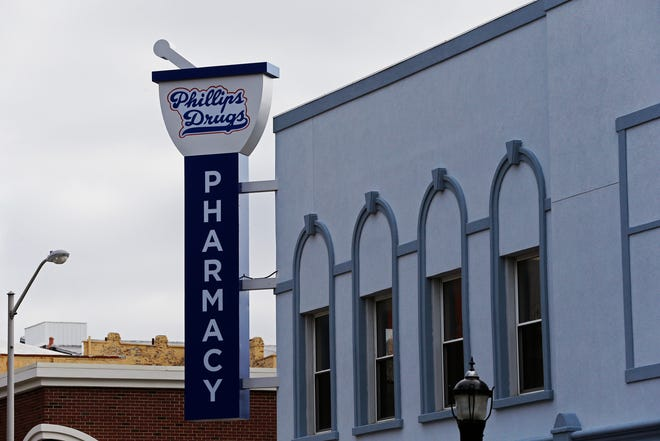 A fourth defendant has been added to a lawsuit filed by Phillips Drugs over water leaking into the pharmacy's basement since the construction of the bike path along East Main Street.