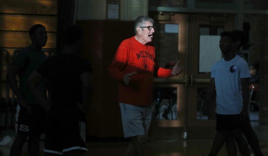 Dick O'Toole, who has been coaching basketball in Rochester for close to 50 years, moves in and out of the late afternoon window light as he works with the junior varsity squad on three-on-two drills during practice at Wilson High Tuesday, Jan. 21, 2020.