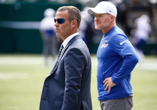 Buffalo Bills general manager Brandon Beane and head coach Sean McDermott, shown watching warmups prior to the season opener against the New York Jets, are in Mobile, Alabama, for the Senior Bowl this week.