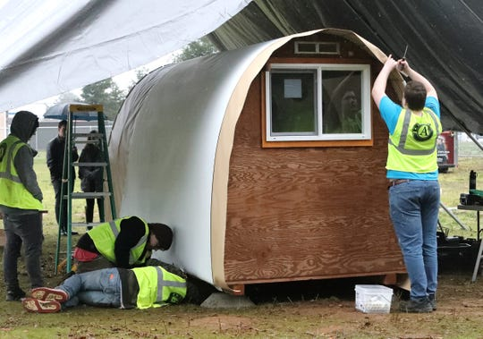 Students from the California Heritage YouthBuild Academy public charter school assemble a micro shelter at their Redding campus off Airport Road on Tuesday, Jan. 21, 2020. Organizer Laural Park envisions a community village of tiny huts, overseen by onsite advisers, where the homeless can live in a safe and stable environment.