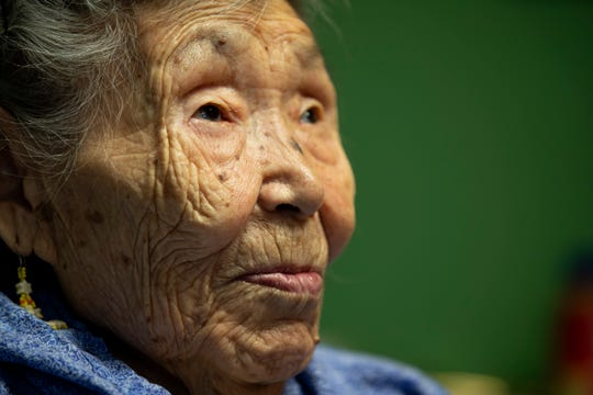 Lizzie Chimiugak looks on at her home in Toksook Bay, Alaska. Chimiugak, who turned 90 years old on Monday, is scheduled to be the first person counted in the 2020 U.S. Census on Tuesday.