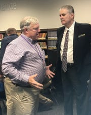 Byrd principal Jerry Badgley makes a point with LHSAA executive director following Tuesday's 2020 area meeting at Airline High School.