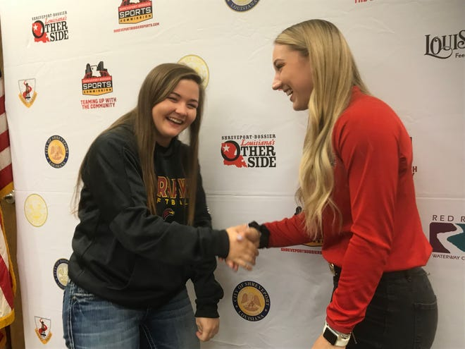 UL Monroe's Jayden Mount and Louisiana Tech's Bayli Simon share a laugh following Tuesday's news conference announcing their teams will play the USA Women's National softball team.