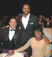 Shreveport Mayor Adrian Perkins stands between pals Earnest and Tangela Sylvie at Krewe Sobek Grand Ball XVII. The mayor sat with them at Table 16.