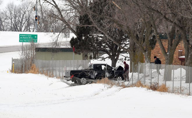 A truck sits tangled in chain link fencing after a crash just ahead of the Western Avenue exit on Interstate 229 on Tuesday, Jan. 21, in Sioux Falls.