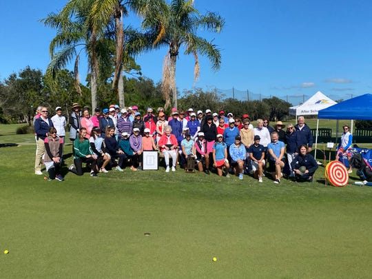 Alma Lee Loy (seated center) poses for a group shot at the fourth annual Alma Lee Loy Team Challenge at Vero Beach Country Club on Monday, Jan. 20, 2020.