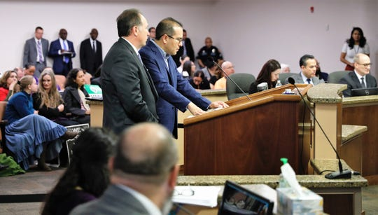 Steve Ortega, right, a former El Paso city representative and lobbyist for the JPMorgan Chase-tied Infrastructure Investments Fund, or IIF,  and Patrick Reinhart, El Paso Electric vice president of governmental affairs, talk to City Council at its  Jan. 21 meeting.