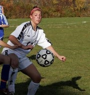 Ashley Manning plays soccer for Somers High School on Nov. 1, 2006.