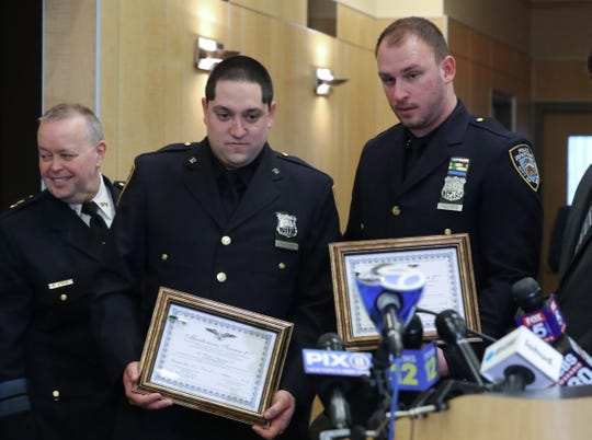 New York City Police Officers Russell Mattera, left, and David Radziwon received several awards for their work in apprehending the person who allegedly carried out the machete attack on Hanukkah celebrants in Monsey Jan. 21, 2020. The awards were presented at the Rockland County Legislature in New City.