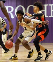 New Rochelle's Jayson McGee (3) dribbles around Tymir Greene (11) of White Plains during boys basketball game at New Rochelle High School on Jan. 21, 2020. New Rochelle defeats White Plains 73-58.