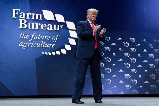 President Donald Trump walks on stage to speak at the American Farm Bureau Federation's convention in Austin, Texas, Sunday, Jan. 19, 2020. (AP Photo/Susan Walsh)