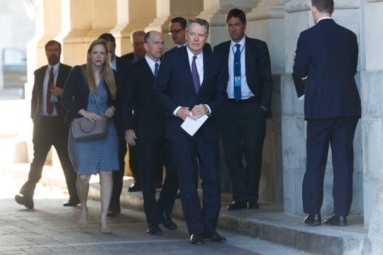 U.S. Trade Representative Robert Lighthizer, center, and members of his staff leave the U.S. Capitol, Thursday, Jan. 16, 2020. Earlier the Senate overwhelmingly approved a new North American trade agreement that rewrites the rules of trade with Canada and Mexico and gives President Donald Trump a major policy win before senators turn their full attention to his impeachment trial.