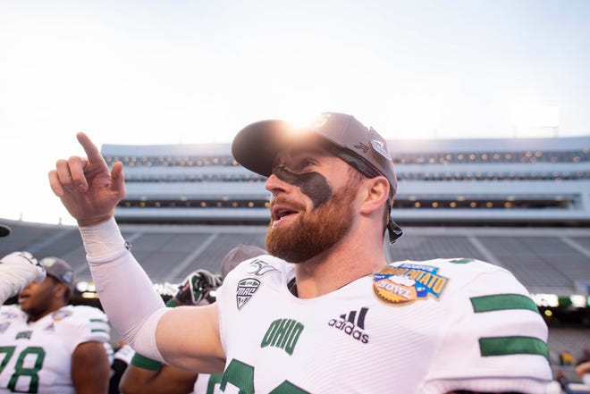 Sheridan grad Devin King takes part in the postgame celebration during Ohio's win against Nevada in the Idaho Potato Bowl in Boise, Idaho. The game marked the final college game for King, who was the team's long snapper for two seasons.