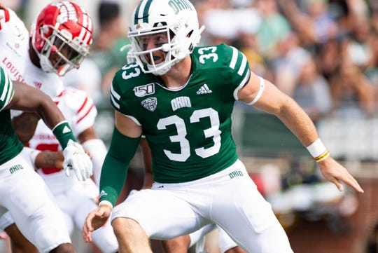 Ohio long snapper Devin King, from Sheridan, looks for a defender during the Bobcats' game against Louisiana last season in Athens. King served as the Bobcats' long snapper for two seasons.