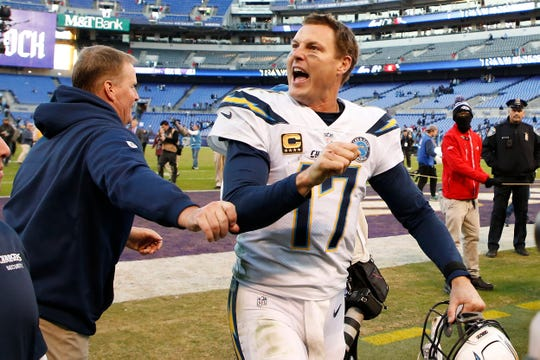 Philip Rivers celebrates after last season's wild-card playoff win over the Ravens.