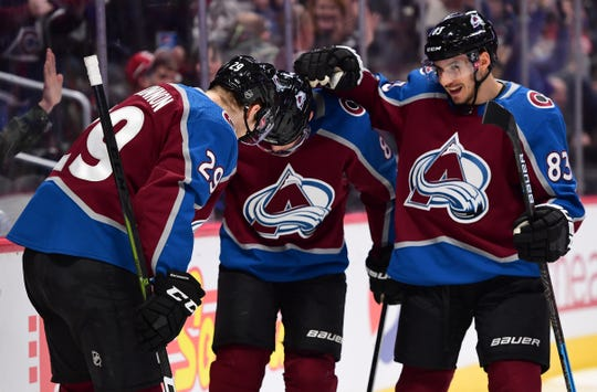 Jan. 20: Colorado Avalanche center Nathan MacKinnon, left, after scoring his 29th goal of the season. He added his 30th goal in the third period.