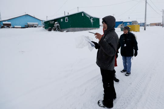 In this Monday, Jan. 20, 2020 photo, census workers verify that their maps match up to the right amount of houses in Toksook Bay, Alaska, a mostly Yup'ik village on the edge of the Bering Sea.