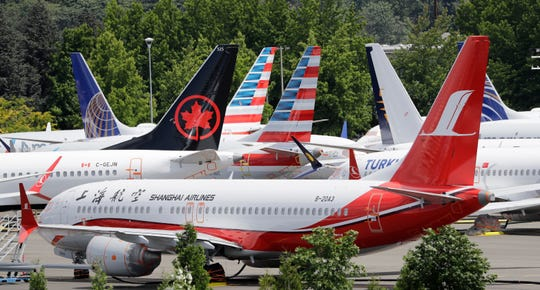 Dozens of grounded Boeing 737 MAX airplanes crowd a parking area adjacent to Boeing Field in Seattle.
