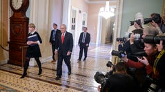 Senate Majority Leader Mitch McConnell walks to the Senate Chamber for the impeachment trial of President Donald Trump on Tuesday.