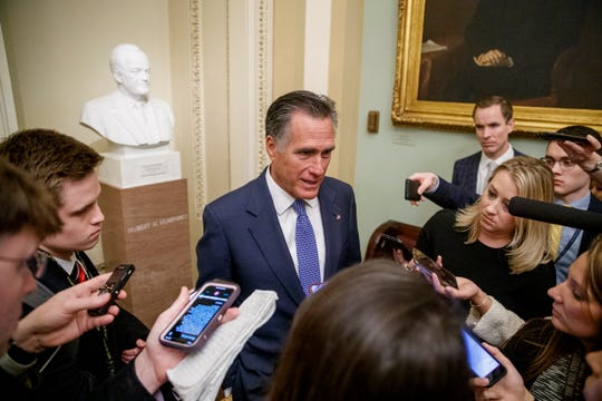Republican Sen. Mitt Romney responds to a question from the media in the U.S. Capitol on Tuesday.