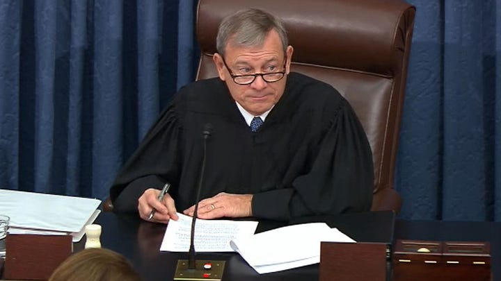 In this screenshot taken from a Senate Television webcast, Supreme Court Chief Justice John Roberts presides over impeachment proceedings against President Donald Trump in the Senate on Tuesday.