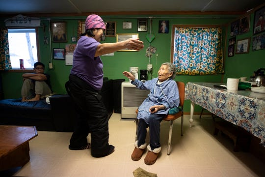 In this Monday, Jan. 20, 2020 image, Lizzie Chimiugak, right, gets a hug from her granddaughter Janet Lawrence at her home in Toksook Bay, Alaska. Chimiugak, who turned 90 years old on Monday, is scheduled to be the first person counted in the 2020 U.S. Census on Tuesday.