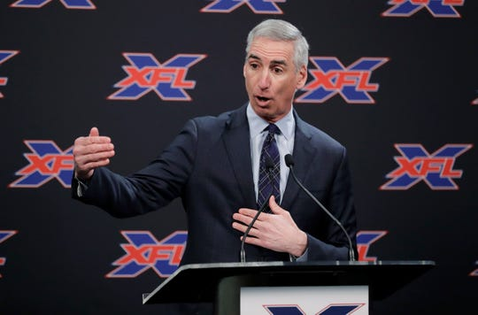 """FILE - In this Feb. 25, 2019, file photo, XFL Commissioner Oliver Luck gestures during a press conference in Seattle.  When the XFL debuts in February, it will take a """"Star Trek"""" approach of going where no football league has gone before. (AP Photo/Ted S. Warren, File)"""