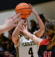 Pendleton High senior Karsen Cheek shoots near Liberty senior Jayda Vaughn during the first quarter at Pendleton High School in Pendleton on Tuesday.