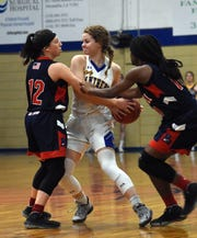Caldwell Parish's Rylie Tate (12) and Danasia Andrews (10) try to steal the ball from Buckeye's Mallori Paulk Tuesday, Jan. 22, 2020. Caldwell won 62-60.