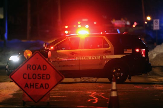An Appleton Police Department vehicle blocks Grove Street where it meets Lynch Avenue Tuesday, January 21 2020, in Appleton, Wis.