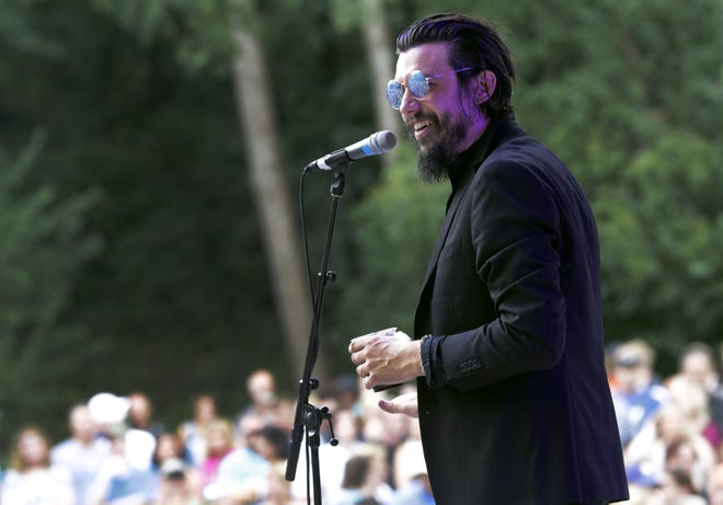 Cory Chisel looks over a large crowd during his performance in Jones Park during the Mile of Music festival in Appleton in 2019.