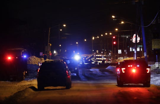 Emergency vehicles line both sides of Grove Street in Fox Crossing after a Jan. 21 police shooting.