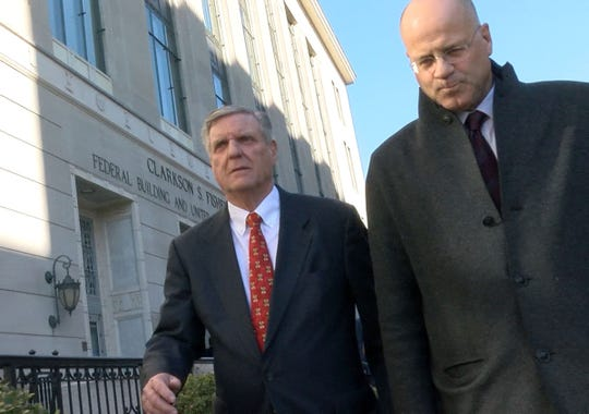 Former Ocean County Republican Chairman George Gilmore (left) leaves the Federal Courthouse in Trenton Wednesday, January 22, 2020, with his attorney Kevin Marino.  Gilmore was sentenced to a year and one day in prison on two counts of failing to submit payroll taxes collected from employees of his law firm and one count of making a false application for a loan from OceanFirst Bank.