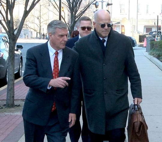 Former Ocean County Republican Chairman George Gilmore (left) arrives at the Federal Courthouse in Trenton Wednesday, January 22, 2020, along with his attorney Kevin Marino.  Gilmore was later sentenced to a year and one day in prison on two counts of failing to submit payroll taxes collected from employees of his law firm and one count of making a false application for a loan from OceanFirst Bank.