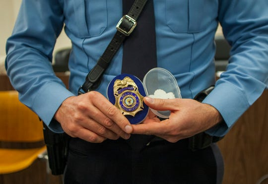 A newly-promoted Lakewood police sergeant holds his badge during the township police promotional ceremony held at the municipal courthouse on Jan. 22, 2020. During the event, Police Chief Greg Meyer announced the creation of a new unit that will focus on reaching out to the township's diverse communities and prioritize actions dealing with homeland security issues.