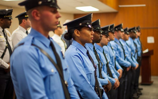 Lakewood police academy stand in line during their swearing-in ceremony held at the township municipal court building on Jan. 22, 2020. Police chief Greg Meyer announced a series of measures aimed at increasing security around Lakewood.