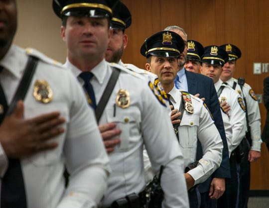 Lakewood police department top brass recite the pledge of allegiance during a department promotional ceremony held at the municipal courthouse on Jan. 22, 2020.