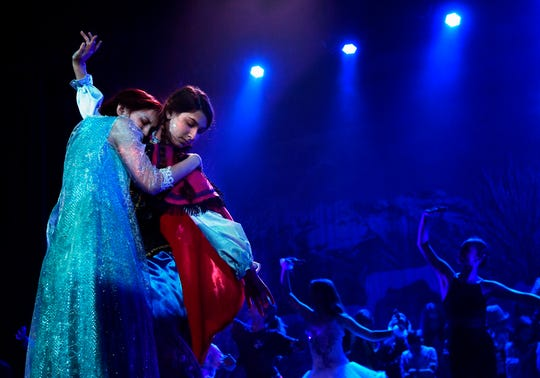 """Anna Claire Boone (left) and Katie Moore perform as sisters Elsa and Anna during rehearsal for """"Frozen Jr."""" Tuesday at the Paramount Theatre."""