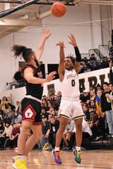Abilene High's Pooh Johnson (0) takes a 3-pointer over a Euless Trinity defender.