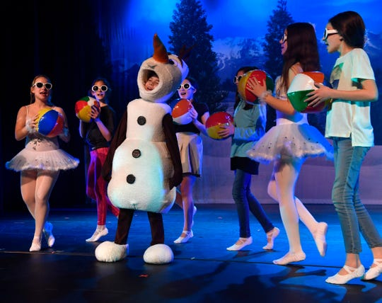"""Phoenix Lowe as Olaf sings about summer during rehearsal for """"Frozen Jr."""" The locally-cast musical will be performed three times this weekend at the Paramount Theatre."""
