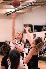 Abilene High's Kelly Boyland (22) takes a shot against Euless Trinity at Eagle Gym on Tuesday.